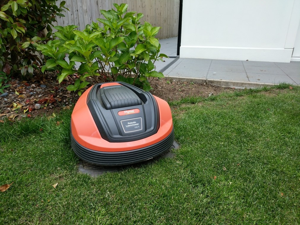 flymo robotic lawnmower in charging station